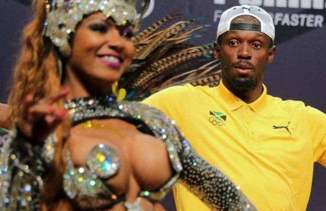21 de Agosto — CAPA • Usain Bolt - 1986 – 31 Anos em 2017 - Acontecimentos do Dia - Foto 22 - Com Escola de Samba no Rio de Janeiro.