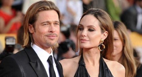 4 de Junho - Angelina Jolie com Brad Pitt.