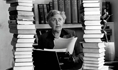 Agatha Christie, surrounded by some of her 80-plus crime novels.