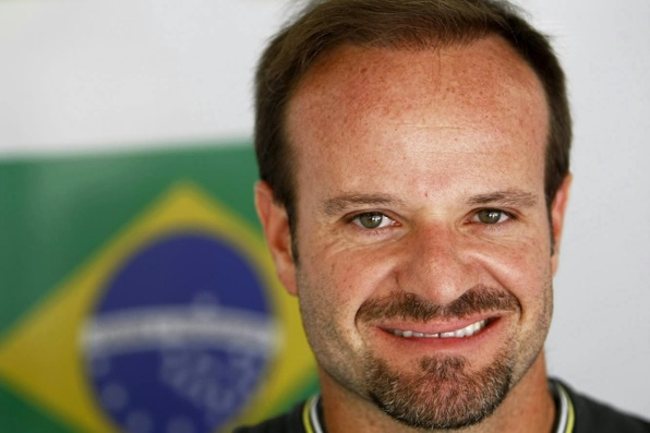 23 de Maio - Rubens Barrichello com bandeira brasileira ao fundo.